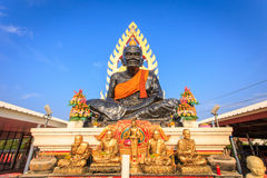 Big black Buddha Stature in Thailand. Big black Buddha Stature with blue sky background in Thailand Royalty Free Stock Photography