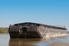 Big black cargo barge is anchored on Danube river Royalty Free Stock Images