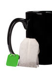 Big black cup and tea bag Royalty Free Stock Photo