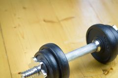 Big black dumbells on wood floor in the huge gym / fitness; spor Royalty Free Stock Images