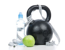Big black fitness weight dumbbell with tape measure Royalty Free Stock Photography