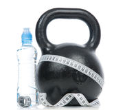 Big black fitness weight with tape measure Royalty Free Stock Photos