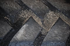Big Black Frontloader Tire treads close-up Royalty Free Stock Photography