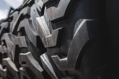 Big black huge big truck, tractor or bulldozer loader tires wheel close-up on stand, shop selling tyres for farming and big vehicl. E moving stock photography
