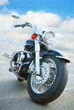 Big black motorcycle. On asphalt against sky royalty free stock photography