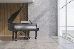 Black piano in a concrete and wooden room Royalty Free Stock Images