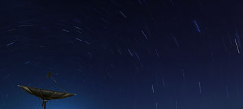 Big Black satellite over star trail Stock Image
