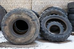 Big black tires in industrial park. Black rubber. Travel urban photo 2019. City Cesis, Latvia. Big black tires in industrial park. Black rubber. Travel urban royalty free stock image