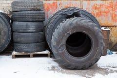 Big black tires in industrial park. Black rubber. Travel urban photo 2019. City Cesis, Latvia. Big black tires in industrial park. Black rubber. Travel urban stock photo