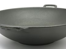 A big black wok for cooking Stock Images