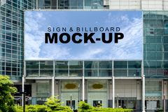 Big blank billboard at modern building. A big Billboard mockup for advertisement on the top of modern building with clipping path stock image