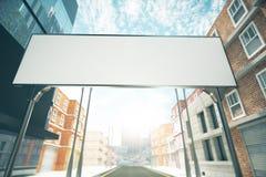 Big blank billboard over the road between buildings Stock Photos