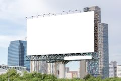 Blank billboard ready for new advertisement with city view backg Royalty Free Stock Photography