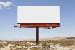 Big Blank Desert Billboard. Big, blank billboard in the middle of the Mojave desert stock images