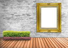 Big Blank frame vintage on a concrete wall with tree pot on wood Royalty Free Stock Photos