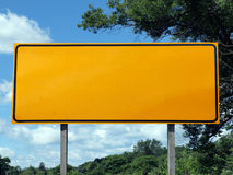Big Blank Highway Sign. With blue sky and summer greens Stock Images