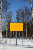 Big outdoor sign. Big blank outdoor sign in winter landscape royalty free stock photo