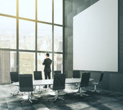 Big blank white picture in loft conference room Royalty Free Stock Image