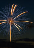 Big Blast. A giant fireworks blast lights the night sky royalty free stock photography
