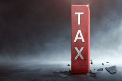 Big block with Tax text coming out from the ground. Taxation concept Royalty Free Stock Photo