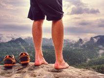 Big bloody callus on man heel. Sandstone rock with hikers legs. Big bloody callus on man heel. Sandstone rock with tired hikers legs without shoes. Outdoor royalty free stock photography