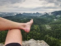 Big bloody callus on man& x27;s heel. Closeup of man feet relax. On rocky summit at edge. Man enjoy view into country young wound wet walk uncomfortable stock image