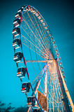 Big blue carousel ferris wheel fairground Royalty Free Stock Image