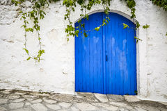 Big blue door and a white wall Stock Images