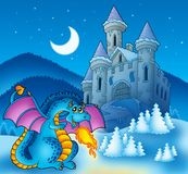 Big blue dragon with winter castle royalty free stock image