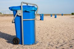 Big blue dust bins at the beach Royalty Free Stock Photo
