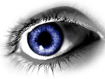 Big Blue Eye. Taken closeup, all colours but blue are desaturated Stock Photo
