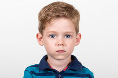 Big blue eyes kid portrait Stock Photo