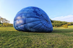 Big blue hot air balloon inflated Royalty Free Stock Photos