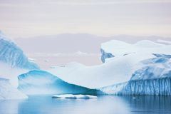 Icebergs in Greenland. Big blue icebergs floating near the Saqqaq village, western Greenland Royalty Free Stock Photography