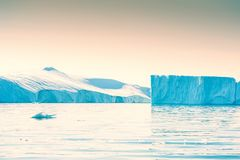 Big blue icebergs in Greenland. Big blue icebergs in the Ilulissat icefjord, Greenland. Vintage filter