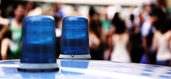 Big blue lights siren of a police car in the big city Royalty Free Stock Photo