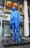 Big Blue Man statue by french artist Xavier Veilhan at Seventh Avenue in midtown Manhattan Royalty Free Stock Photo