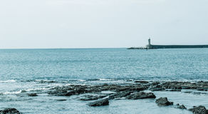 The big blue Mediterranean Sea. On of the lighthouse of the Livorno harbor Stock Image