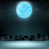 Big blue moon over city Royalty Free Stock Photography