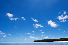 Big blue ocean and blue blue sky Stock Photos