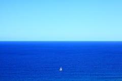 Big Blue Ocean Small White Sailing Boat Vastness Stock Image