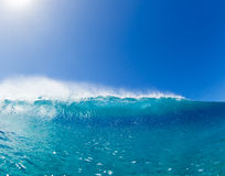 Big blue ocean Wave sunny sky. Blue Ocean Wave splashing under sunny sky Royalty Free Stock Images
