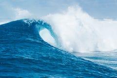 Big blue ocean Wave sunny sky. Blue Ocean Wave splashing under sunny sky Stock Images