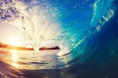 Big blue ocean Wave sunny sky. Blue Ocean Wave splashing under sunny sky Royalty Free Stock Image