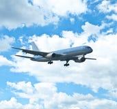 Big blue passenger plane at blue sky Stock Photos