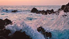 Big blue rough ocean surfing waves slowly splash, crash, break. Rolling tropical Thailand beach. Suncet. Big blue rough ocean surfing waves slowly splash, crash stock footage