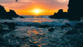 Big blue rough ocean surfing waves slowly splash, crash, break rolling tropical Thailand beach. Suncet. Big blue rough ocean surfing waves slowly splash, crash stock video