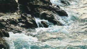 Big blue rough ocean surfing waves slowly splash, crash, break. Rolling tropical Thailand beach. Suncet close-up. Big blue rough ocean surfing waves slowly stock footage