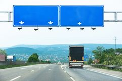 Big blue sign on highway Stock Photo