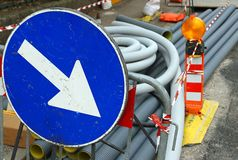 Big blue sign with white arrow during excavation work on the str Stock Photos